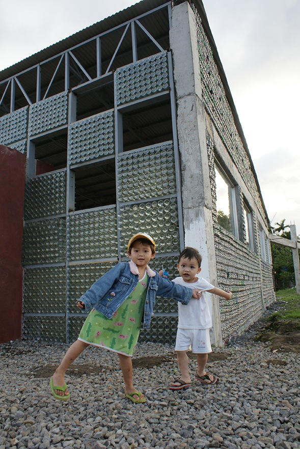 The innovative bottle building was conceived as a way of turning a negative - an abundance of discarded plastic bottles - into a positive - a brand new school for children. PHOTO: KRISTEL MARIE FUENTES GONZALES